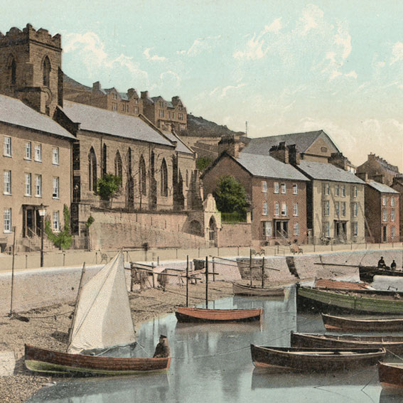 Early 1900's hand coloured photo of fishing boats, fishing nets and the ferry in Church Bay, Aberdovey